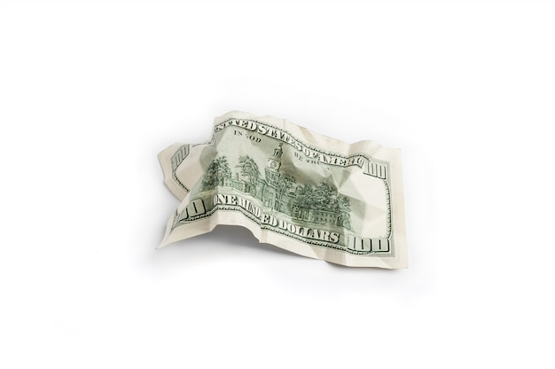 Minted bill of one hundred dollars kind of reverse side on a white background is insulated. Premium Photo