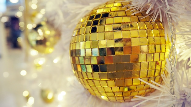 Mirrored disco ball and christmas decorations on a white background. Premium Photo