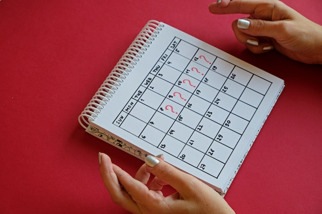 Missed period and marking on calendar. unwanted pregnancy and delay in menstruation. Premium Photo