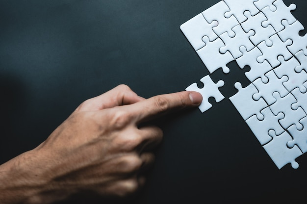 Missing jigsaw puzzle piece, business concept for completing the final puzzle piece Premium Photo