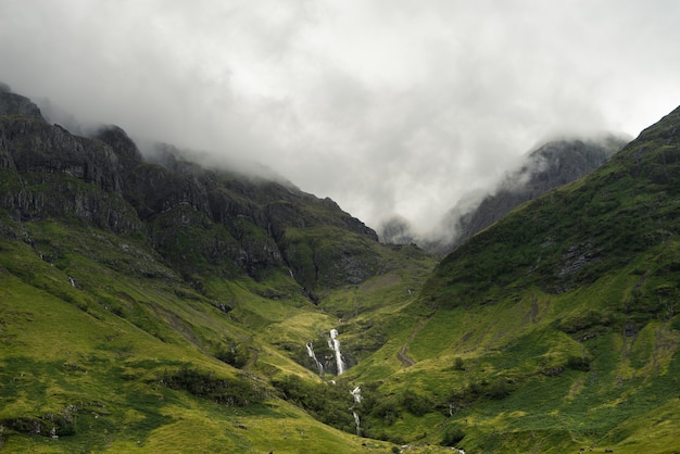 Mist descending on the mountains of scotland during daytime Free Photo