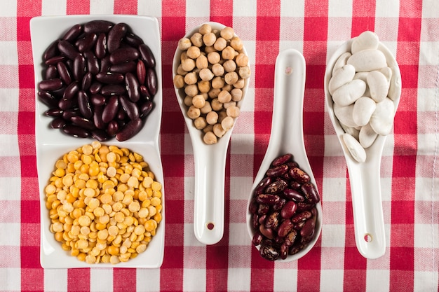 Mix of beans on wooden table Premium Photo