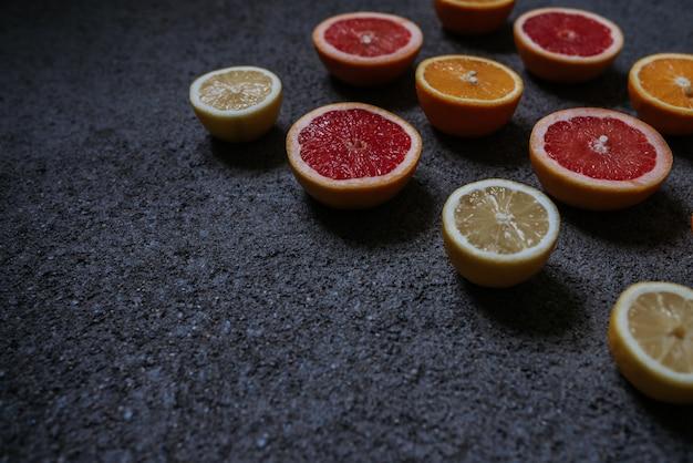 Mix of citrus fruits on concrete background Premium Photo