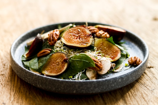 Mix of figs and nuts on plate Free Photo