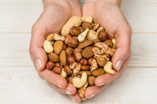 Mix of nuts in hands Premium Photo