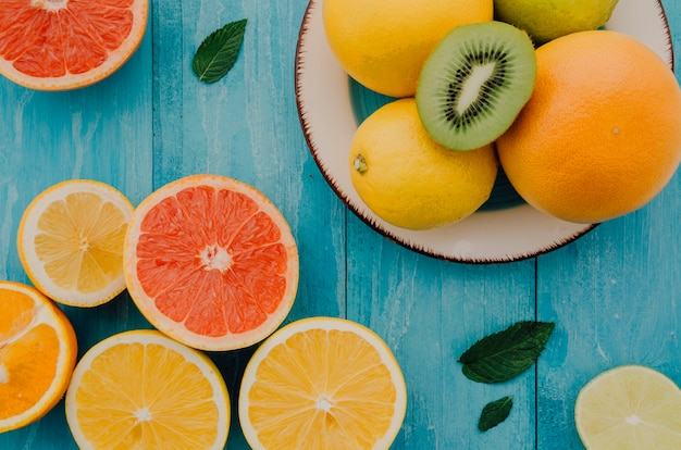 Mix of organic fresh fruits on table Free Photo