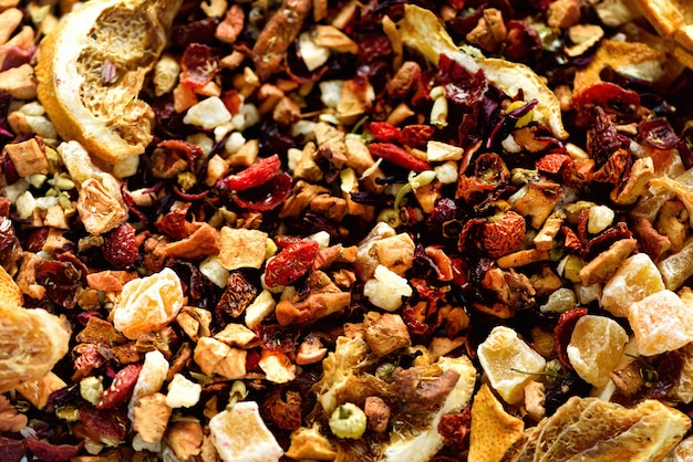 Mix tea karkade with dried fruits and flowers. fruit tea and texture. food. organic healthy herbal leaves, detox tea. Premium Photo