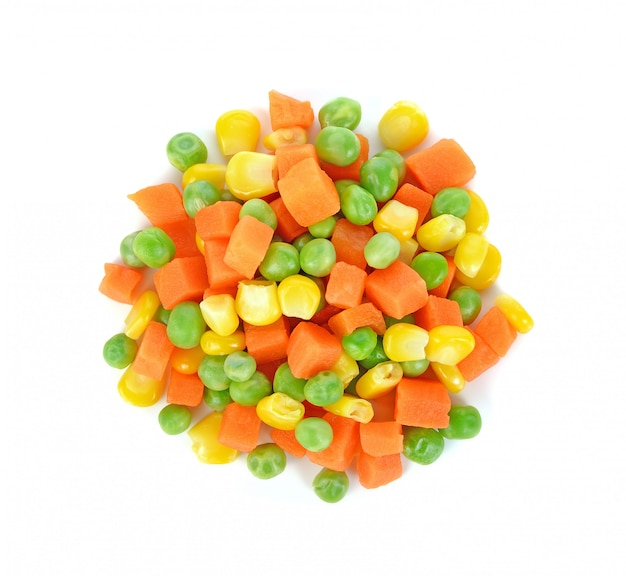 Mix of vegetable containing carrots, peas, and corn on white Premium Photo
