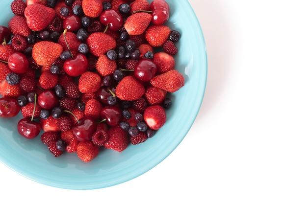 Mixed berries on a blue dish Free Photo