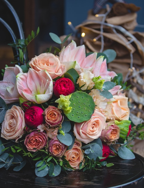 A mixed bouquet in christmas lights background Free Photo