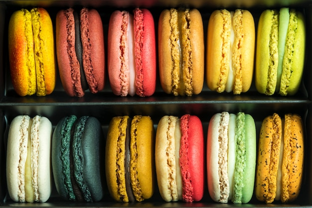 Mixed colorful french macaroons in box. sweet food pattern ...