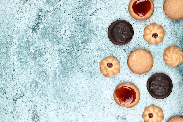 Mixed cookies on a blue background. Free Photo