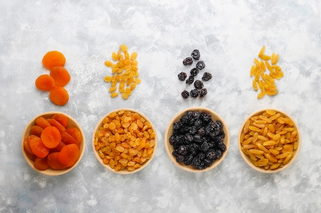 Mixed of dried fruits ,apricots, grapes,plums on light Free Photo
