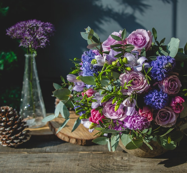 Mixed flower bouquet on a wooden table Free Photo