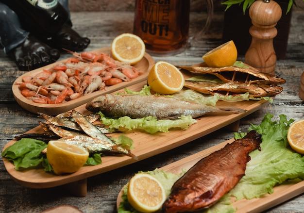 Mixed fried fish with lemon Free Photo