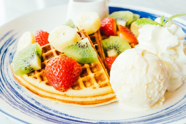 Mixed fruit on top of pancake and ice cream Free Photo