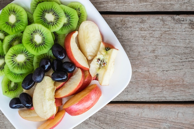 Mixed fruits with apples and kiwi and healthy grapes Premium Photo