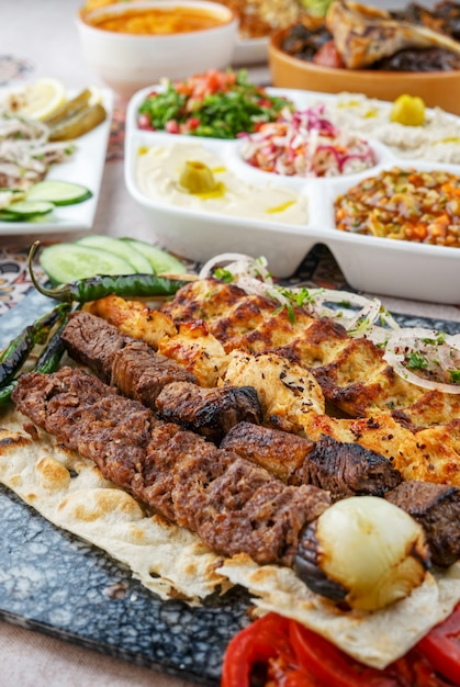Mixed grills, kebab, tikka,  egyptian cuisine, middle eastern food, arabian mezza, arabian cuisine, arabian food Premium Photo