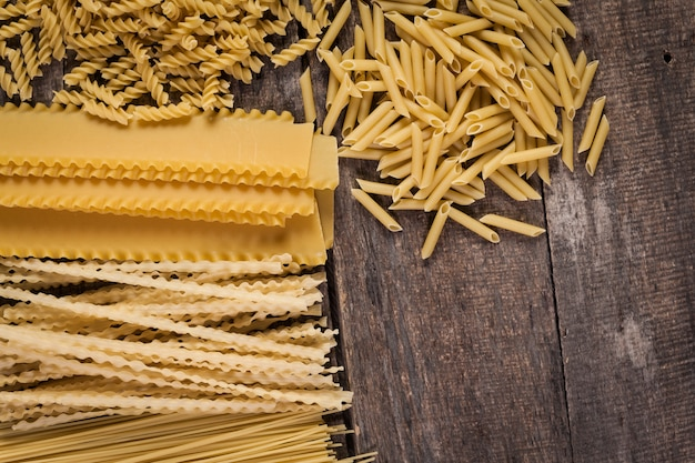 Mixed pasta . on a wooden . top view Premium Photo