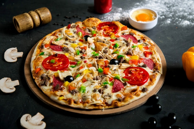 Mixed pizza with various ingridients Free Photo