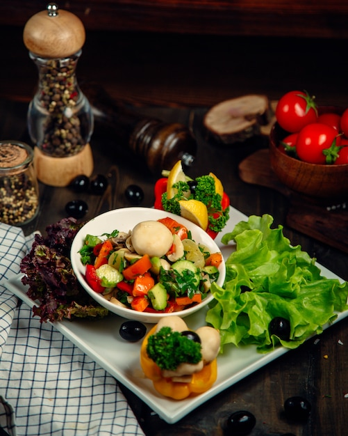 Mixed salad served with various vegetables Free Photo