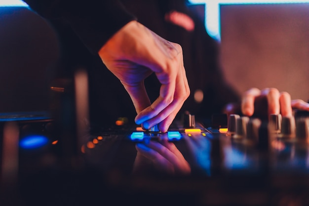 The mixer. remote for sound recording. sound engineer at work in the studio. sound amplifier mixing console equalizer. record songs and vocals. mixing tracks. audio equipment. work with musicians. dj. Premium Photo