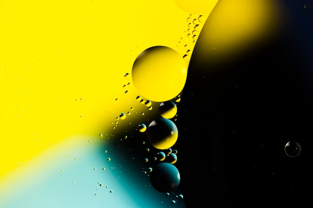 Mixing water and oil on a coloured liquid abstract background Free Photo