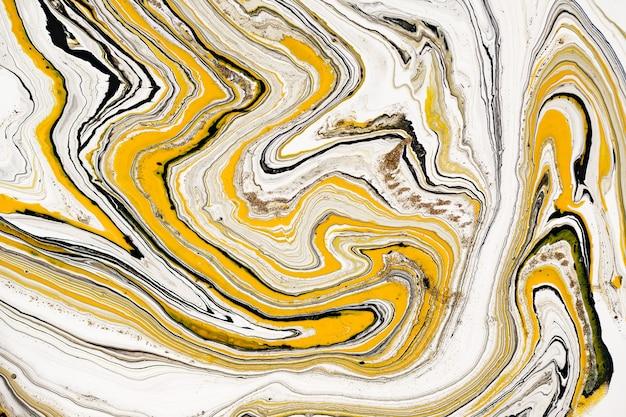 아크릴 물감의 혼합물. 현대 미술품. 노란색과 검은 색 혼합 아크릴 물감. 액체 대리석 질감. 프리미엄 사진
