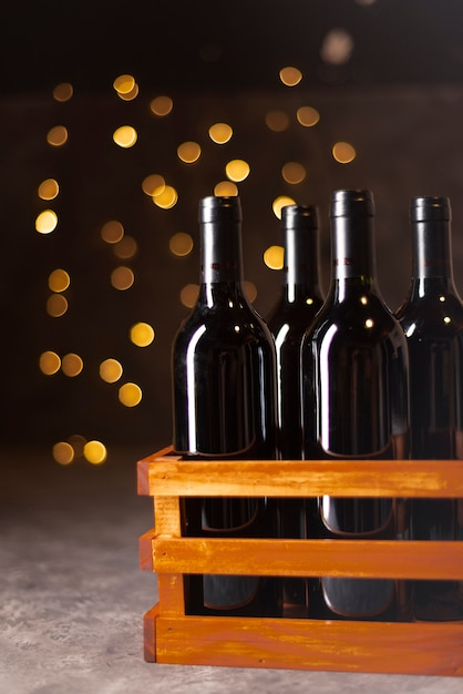 Mixture of wine bottles with bokeh Free Photo