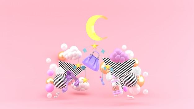 ピンクのスペースにカラフルなボールが並ぶモバイルバッグ、靴、月、星 Premium写真