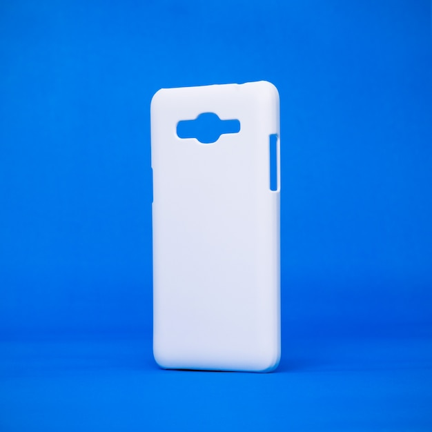Mobile cases on vivid blue backdrops. Premium Photo