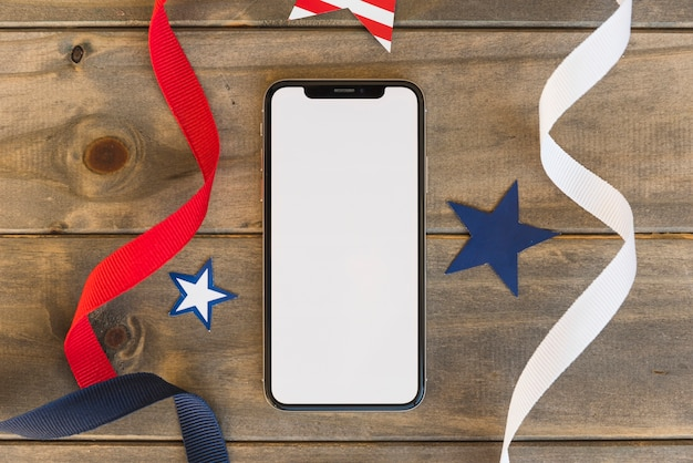 Mobile phone with decorative elements of symbols of america Free Photo