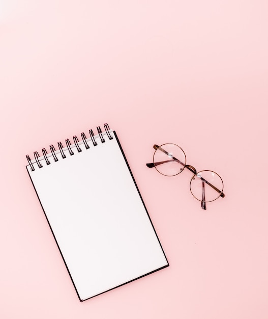 Mock up on abstract background. glasses and black pencil. educational concept Premium Photo