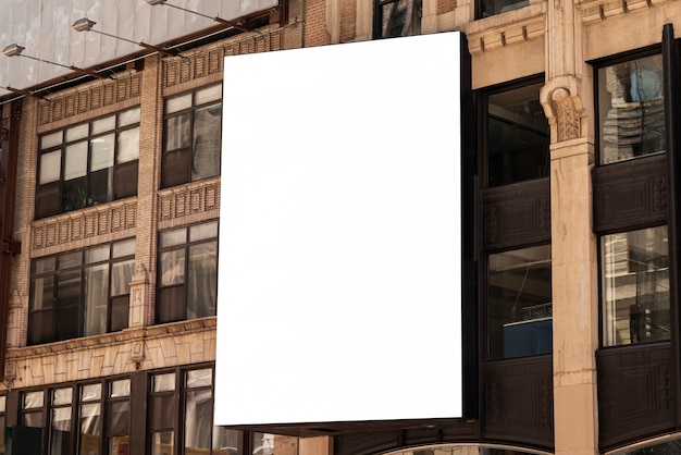 Mock-up billboard on a city building Free Photo