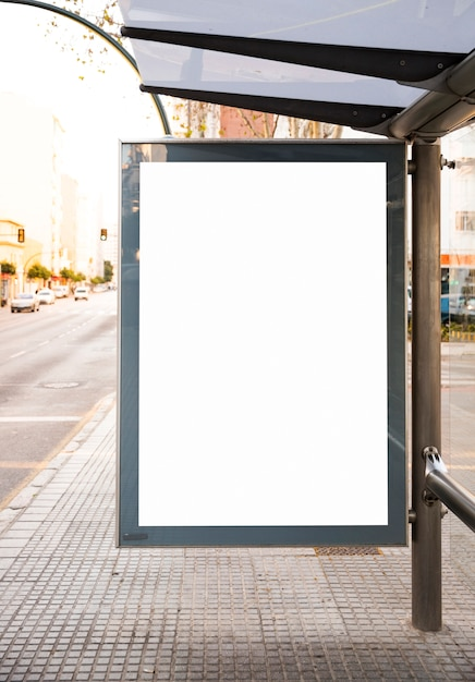Mock up billboard light box at bus shelter outdoor street sign display Free Photo