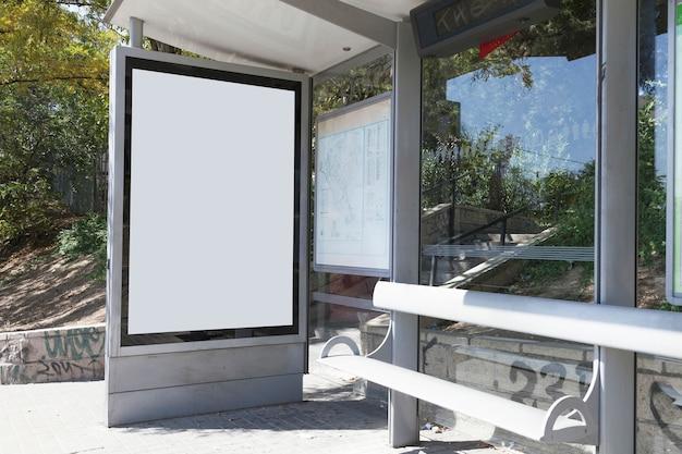Mock up billboard light box at bus shelter Free Photo