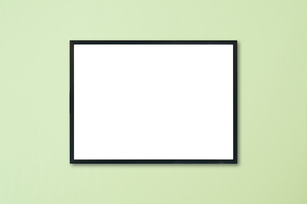 Mock up blank frame hanging on wall in room Premium Photo