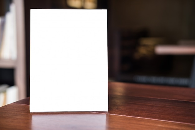 Mock up blank menu frame on table in coffee shop stand for your text Premium Photo