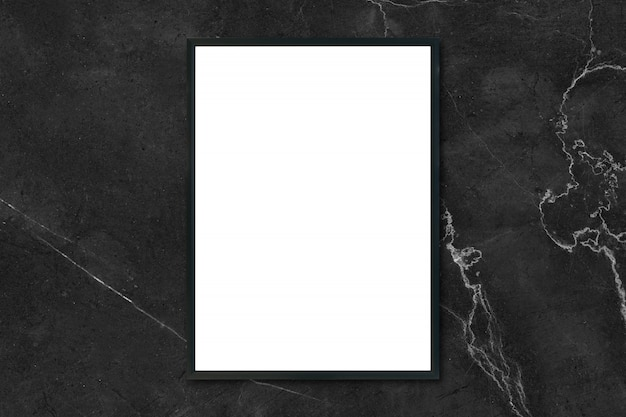 Mock up blank poster picture frame hanging on black marble wall in room Free Photo