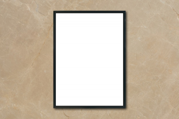 Mock up blank poster picture frame hanging on brown marble wall in room - can be used mockup for montage products display and design key visual layout. Free Photo
