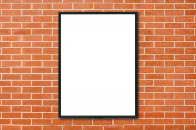 Mock up blank poster picture frame hanging on red brick wall background in room Free Photo