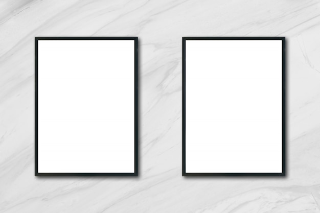 Mock up blank poster picture frame hanging on white marble wall in room - can be used mockup for montage products display and design key visual layout. Free Photo