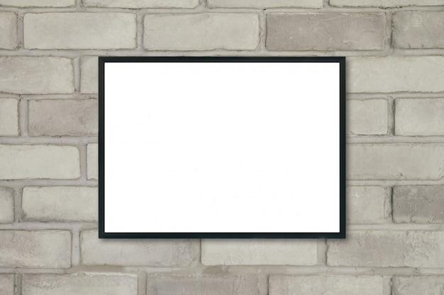 レンガの壁に空白のポスター額縁をモックアップします。 Premium写真