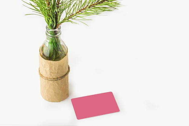 Mock up of christmas gift or note card. fir tree branch Premium Photo