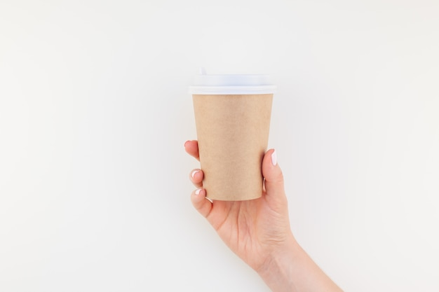 Mock up of coffee cup in female hand Premium Photo