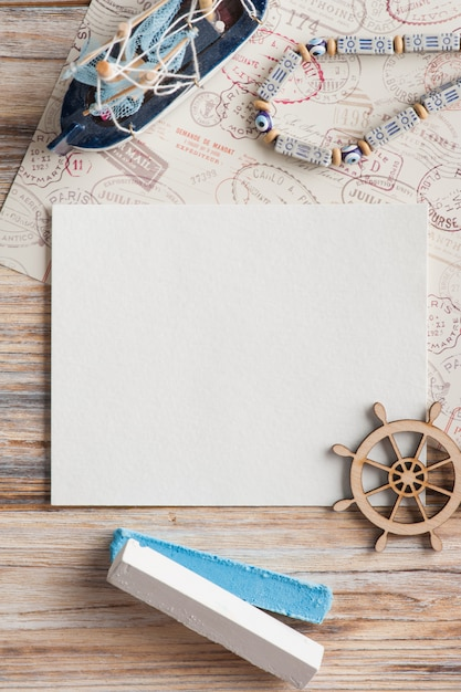 Mock-up, empty paper note, boat and stamps Premium Photo