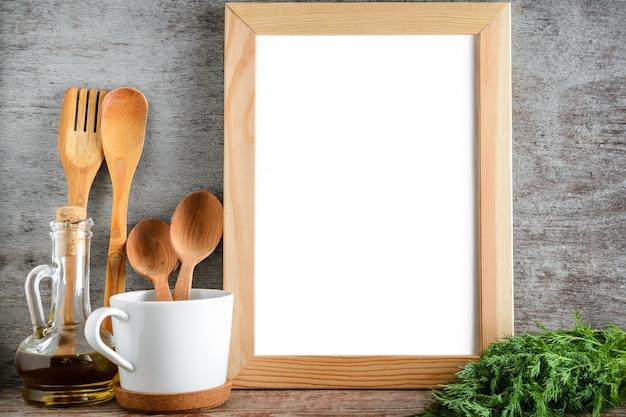 Mock up frame photo utensil and olive oil in kitchen room Premium Photo
