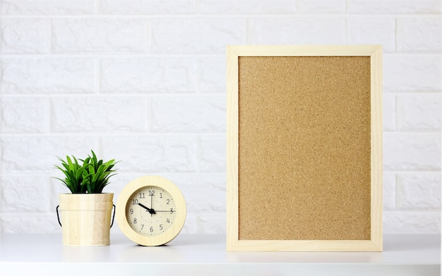 Mock up interior wood frame poster and tree in room office on white brick wall background Premium Photo