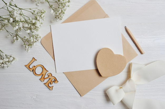 Mock up letter with a love box in the shape of a heart lies on table. valentine dating Premium Photo