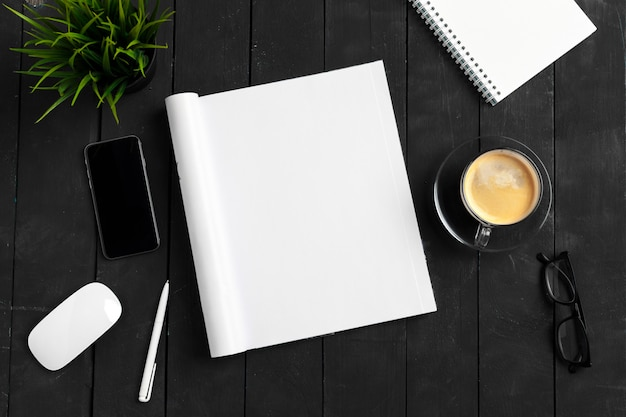 Mock-up magazine or catalog on a wooden table. Premium Photo